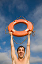 Boy & lifebuoy Stock Photography