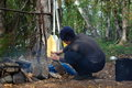 Boy lighting a camp fire water hike across the kola peninsula Royalty Free Stock Photography