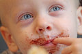 Boy likes cookie ate and smudged his face Royalty Free Stock Photography
