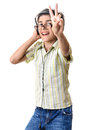 Boy listening cool music headphones with and glasses looking at camera showing victory sign isolated on white background Stock Photos
