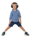 Boy listening music in headphones Royalty Free Stock Photo