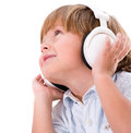 Boy listening to music with headphones isolated over a white background Stock Images