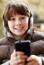Boy Listening To Music On Smartphone Royalty Free Stock Photography