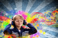 Boy listening to music young with headphones with colorful funky grunge retro background Stock Photo