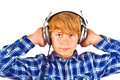 Boy listens to music with his Royalty Free Stock Photo