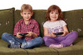 Boy and little girl play video game Royalty Free Stock Photo