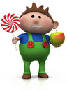 Boy with lollipop and apple Royalty Free Stock Photo