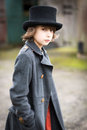 Boy in Long Coat and Top Hat Royalty Free Stock Photo