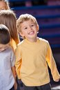 Boy looking away with friends in kindergarten happy little Stock Photography