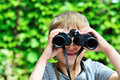 Boy looking through binocular Stock Image
