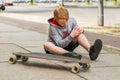 Boy Looking At His Injured Leg