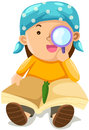 Boy looking through a magnifying glass Royalty Free Stock Images
