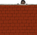 Boy looking over wall cute hispanic brick Royalty Free Stock Image