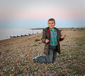 Boy looking for shells photo of a young seashells on the kent coast of whitstable Royalty Free Stock Photography