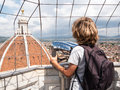 Boy looking through a sightseeing binoculars the dome of basilic tourist concept basilica di santa maria del fiore saint mary Stock Images