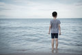 Boy looking to the ocean Royalty Free Stock Photo
