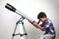 A boy looks through a telescope Royalty Free Stock Photo