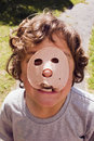 Boy with luncheon meat on face Stock Photography