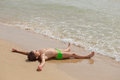 Boy lying on the beach and sunning Royalty Free Stock Photo