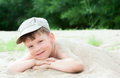 Boy  lying down on the sea beach Stock Images