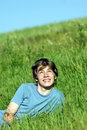 Boy lying on the fresh green grass Royalty Free Stock Photos