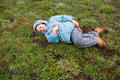 Boy lying on grass Stock Images