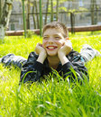 Boy lying on green Stock Photos