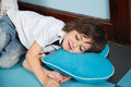 Boy lying on heartshaped pillow in kindergarten cute little Stock Photo