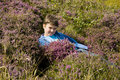 Boy lying in the heather Royalty Free Stock Images