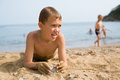Boy lying on the sea beach Royalty Free Stock Images