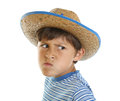 Boy with mad face and cowboy hat Stock Images