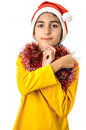 Boy making cross sign at christmas religious in santa clothes Royalty Free Stock Image