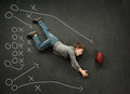 Boy making a diving catch for football with play around him Stock Image
