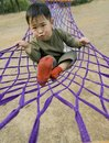 Boy making faces in hammock Royalty Free Stock Images