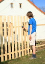 Boy making fence Royalty Free Stock Photo