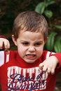 Boy making scary face Stock Images