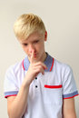 Boy making silence gesture teenage Stock Photos