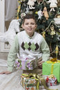Boy with many christmas gifts young Stock Photos
