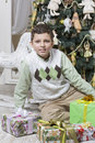Boy with many christmas gifts young Royalty Free Stock Images