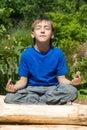 Boy Meditating At Nature