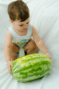 Boy with melon Royalty Free Stock Image