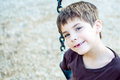 Boy with missing front teeth smiling young at the playground Royalty Free Stock Images