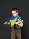 Boy with a model airplane little playing Stock Images