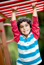 Boy at the monkey bars Royalty Free Stock Photography