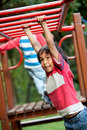 Boy on the monkey bars Royalty Free Stock Photos