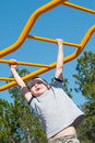 Boy on monkey bars Royalty Free Stock Images
