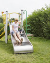 Boy with mother on slide Royalty Free Stock Photography