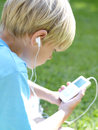 Boy with mp player rear view Royalty Free Stock Photography