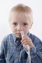 Boy and nasal aspirator Royalty Free Stock Photo