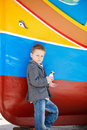 Boy near colorful boat Royalty Free Stock Image